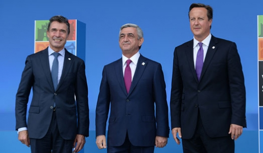 From left to right: NATO Secretary General, President of Armenia and Prime Minister of Great Britain.